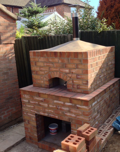 http://www.thestonebakeovencompany.co.uk/wp/wp-content/uploads/mezzo-wood-fired-brick-enclosure-stone-bake-oven.jpg